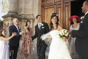 A happy couple leaving the church at their wedding