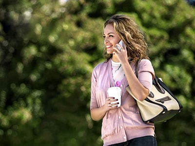 Woman talking on the phone after getting Starbucks coffee